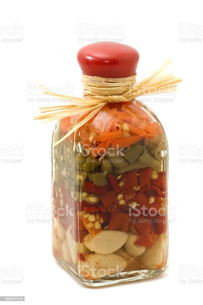 Decorative bottle with sealed colorful spices inside on white royalty-free stock photo