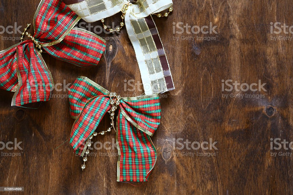 Decorative bows on the table. Christmas stock photo