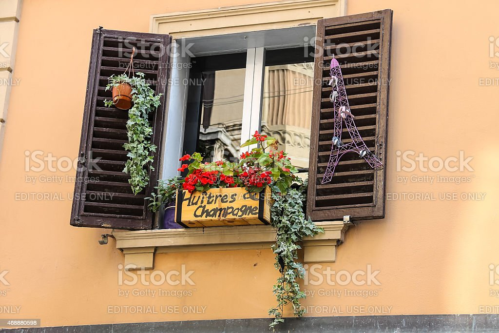 Decorative Box With Flowers Over French Food And Wine Shop Stock