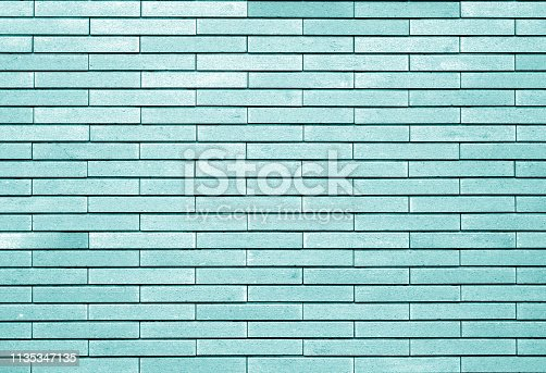Decorative brick wall in cyan tone. Abstract background and texture for design.