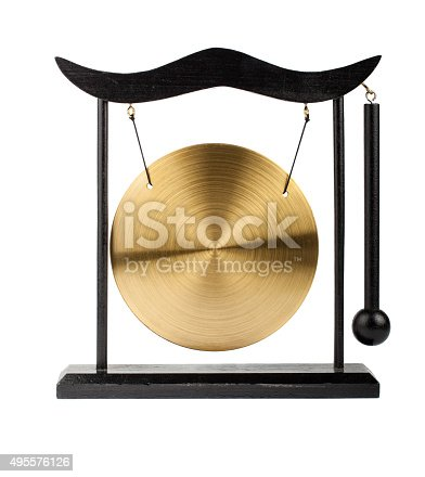 Decorative bronze gong isolated on white background