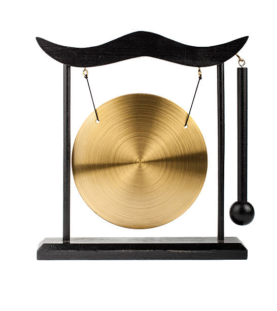 Decorative bronze gong Decorative bronze gong isolated on white background cymbal stock pictures, royalty-free photos & images