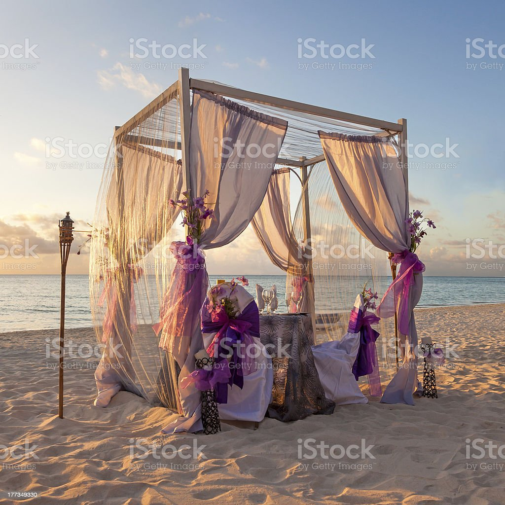 Decorative canopy on Caribbean beach at sunset stock photo