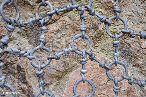 Close up iron chain rings in front of Stonewall