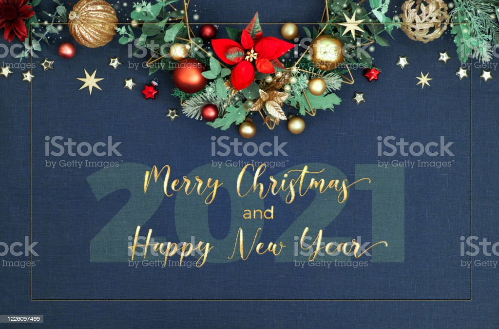 Poinsettias For Christmas 2021 Decorative Christmas Border Merry Christmas And Happy New Year 2021 Floral Garland With Eucalyptus Toys Red Poinsettia Red Green And Golden Xmas Decorations On Classic Blue Linen Background Stock Photo Download