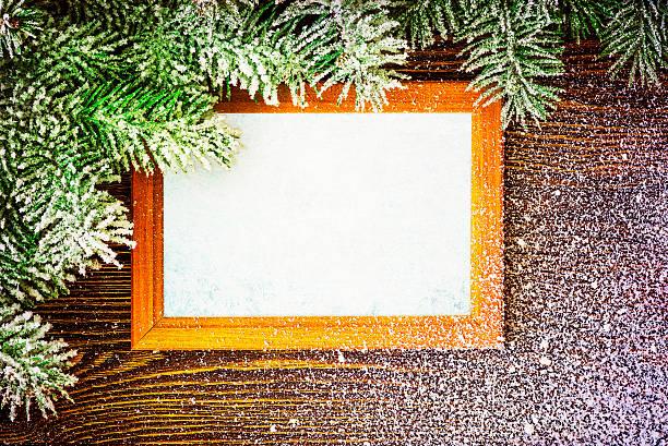 Decorative Christmas frame and needles, happy holidays stock photo