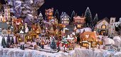 """Brummen, Netherlands - December 24, 2011: Decorative christmas village with Charles Dickens theme. The houses and figurine are made by Department56 and Lemax. Two companies specialised in christmas decorations."""