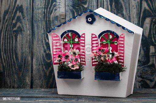 istock Decorative Colorful Metal Handmade Mailbox on Blue 987627158
