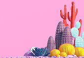 istock Decorative composition of groups of different species of multicolored cacti on pink background. 1073054344
