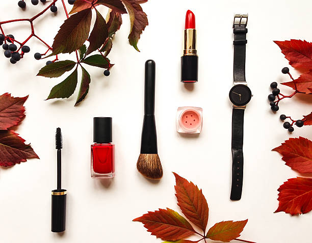 decorative composition with cosmetics, woman accessories. flat lay, top view - herbst nagellack stock-fotos und bilder