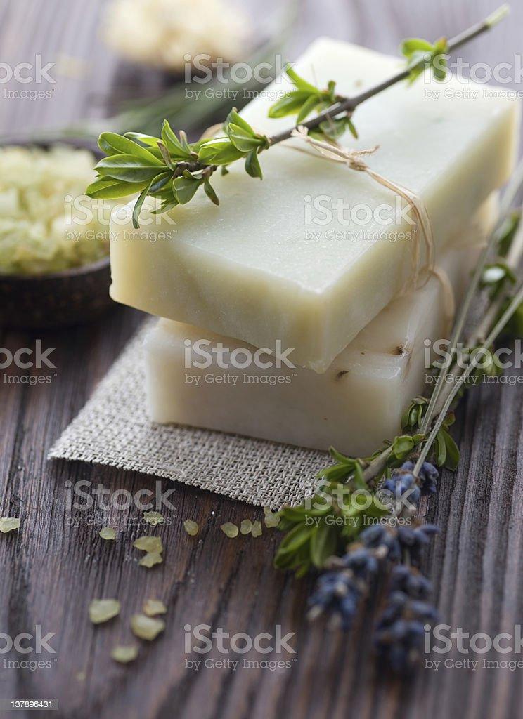 Decorative cream colored bath bat and lavender sprigs stock photo