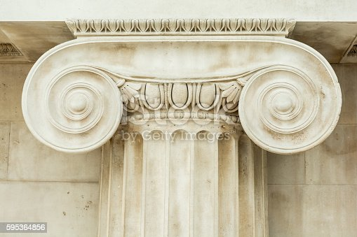 istock Decorative detail of an ancient Ionic column 595364856
