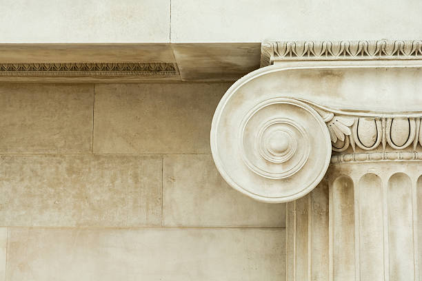 decorative detail of an ancient ionic column - roman stock photos and pictures