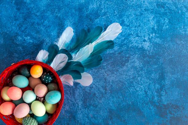 Decorative easter eggs in nest and feathers dark blue background picture id1215093692?b=1&k=6&m=1215093692&s=612x612&w=0&h=am7rptup1lpfvxtpciuiufdvkhx4x  l6egxg58wghc=