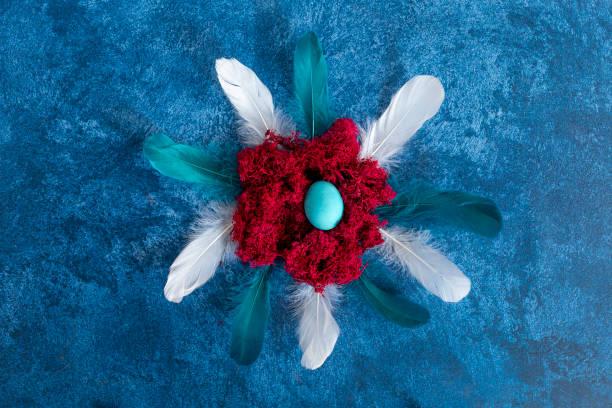 Decorative easter eggs in nest and feathers dark blue background picture id1215093696?b=1&k=6&m=1215093696&s=612x612&w=0&h=7egmbj3w3szxpxxwnhusbczvghu rzswyjatlzjtp5w=