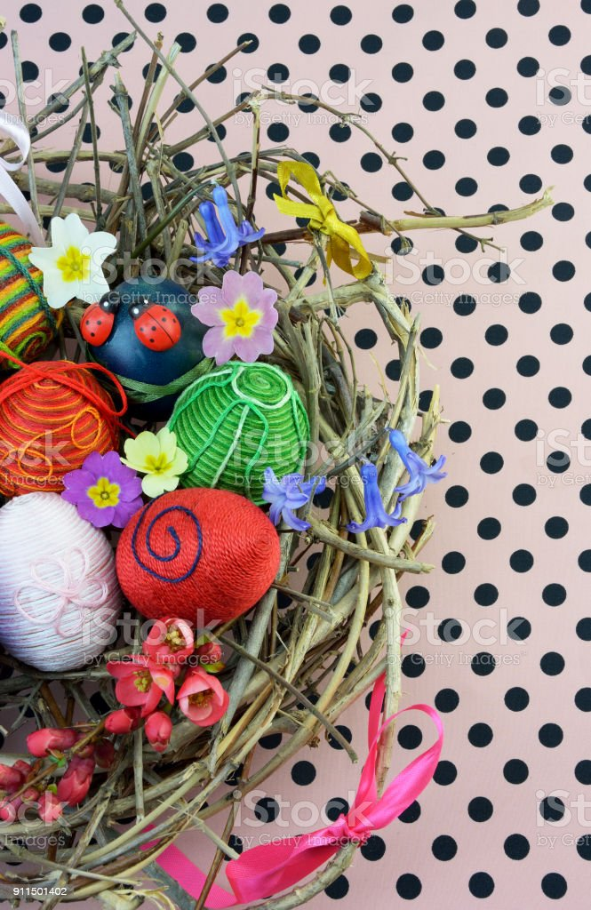 Decorative Easter eggs in nest stock photo