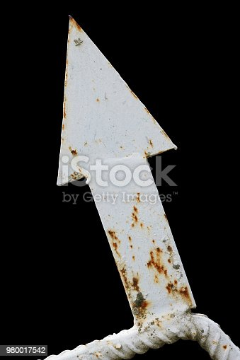 924754302 istock photo Decorative element of a rural fence - iron rusty white arrow 980017542