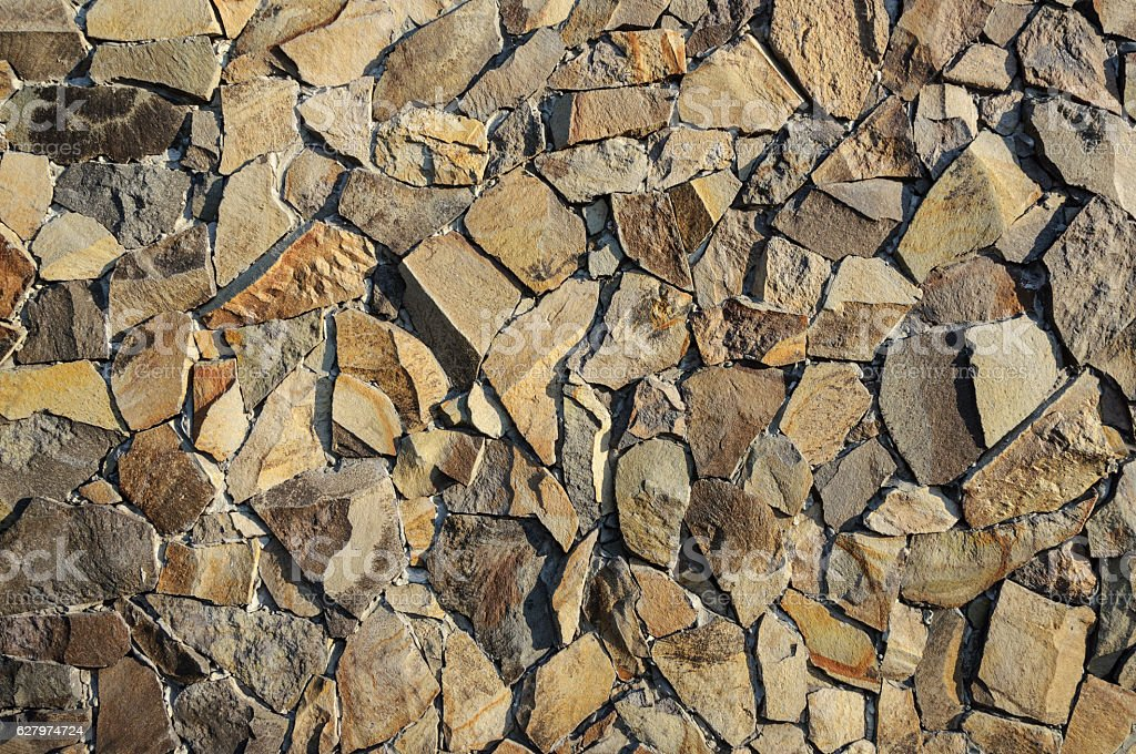 Decorative facing of stone wall stock photo