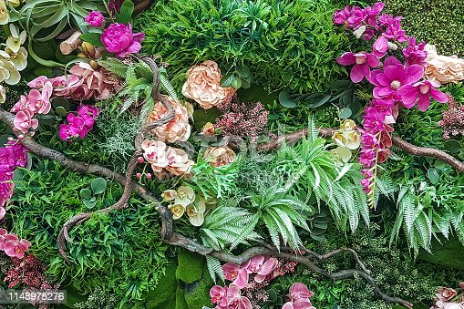 Decorative fake tropical floral arrangement as background or texture.