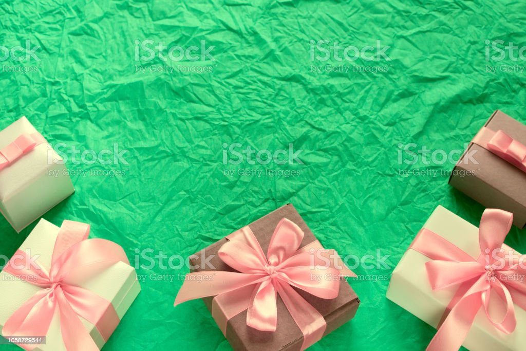 Decorative festive background with gift boxes. Textured green...