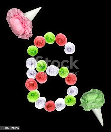 istock Decorative figure of six lined paper flowers 615795026