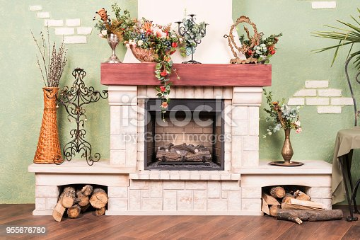 629801250istockphoto Decorative fireplace, as part of the interior 955676780