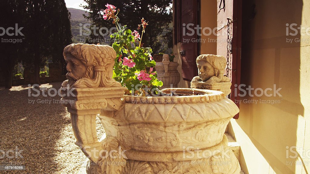 Decorative Flower Pot with Sculptures in Florence, Italy stock photo