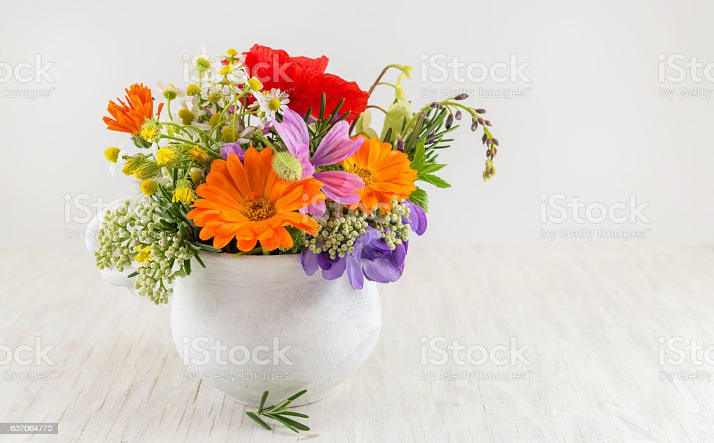 Decorative flowers in a white vase stock photo