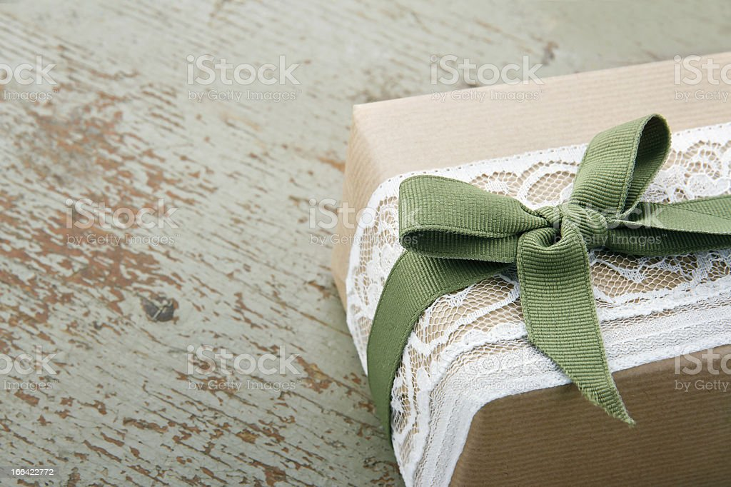 Decorative gift box wrapped in brown eco paper royalty-free stock photo