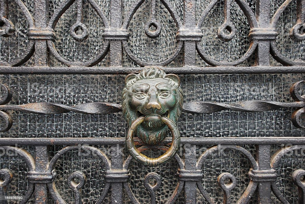 Decorative gilded lion head door knob stock photo