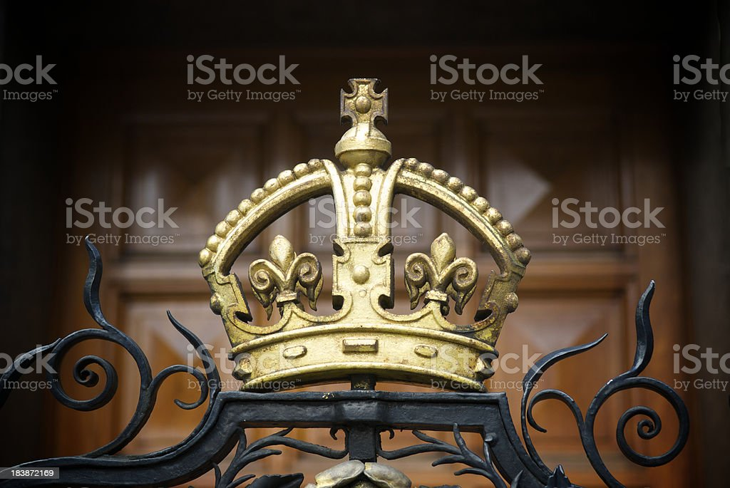 Decorative Gold Crown on Wrought Iron Gate stock photo
