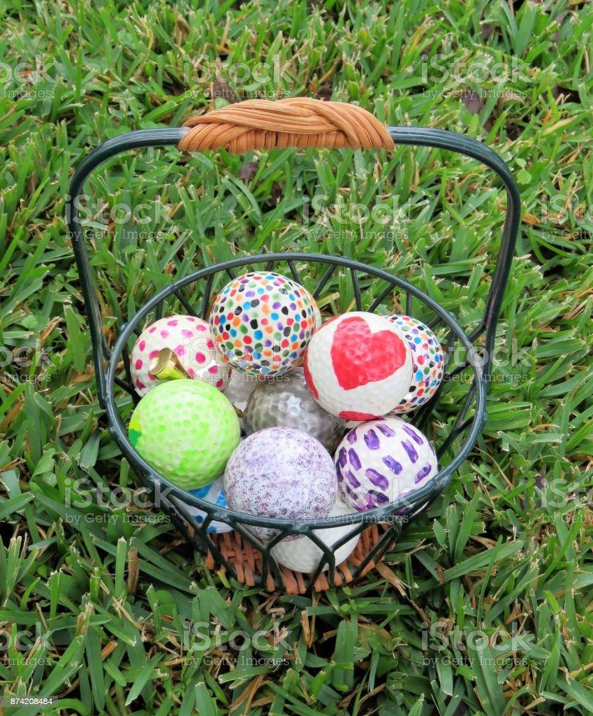 Decorative Golf Balls U0026 Gold Tee In A Basket Royalty Free Stock Photo