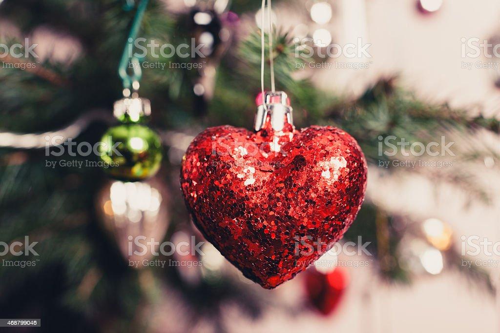 Decorative heart on christmas tree stock photo