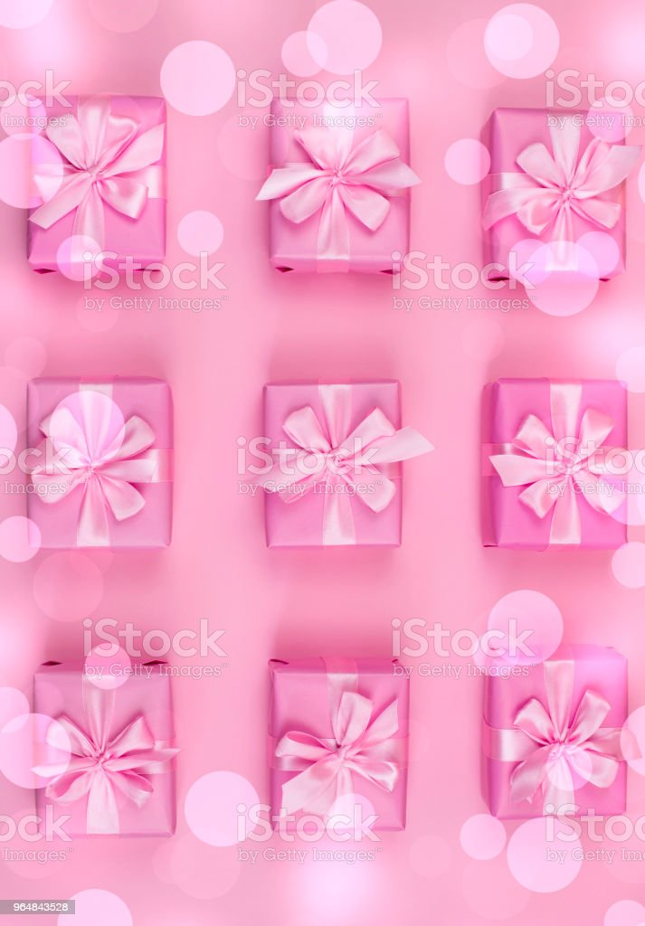 Decorative holiday gift boxes with pink color on pink background. royalty-free stock photo