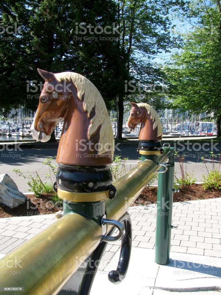 Decorative horse heads topped gate stock photo