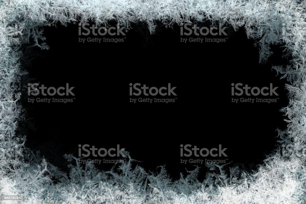 Decorative ice crystals frame on black matte background