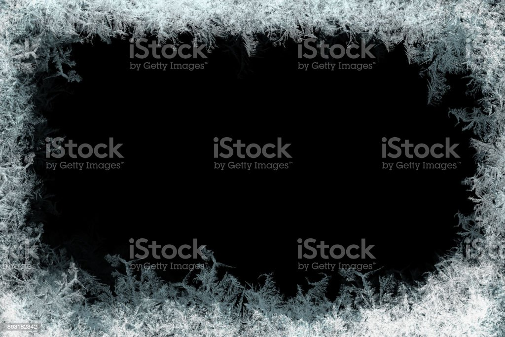 Decorative ice crystals frame on black matte background stock photo