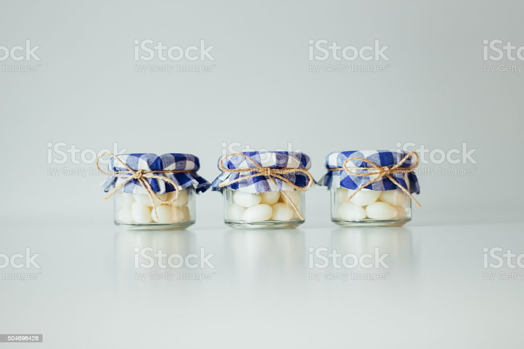 Decorative jars with candies stock photo