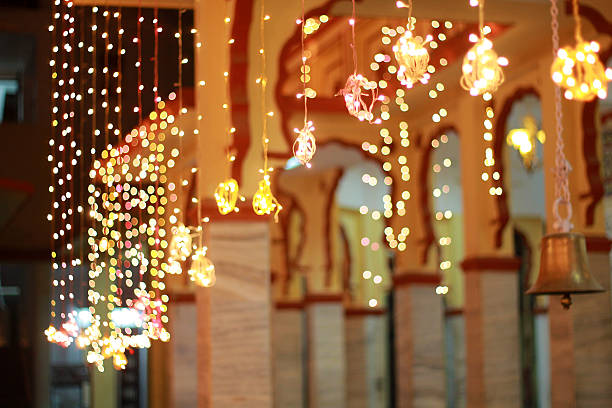 decorative lights in a temple - diwali stock pictures, royalty-free photos & images