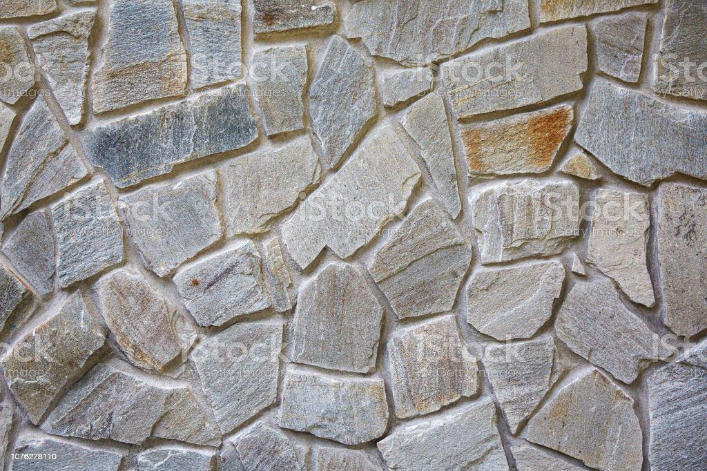 Decoratieve metselwerk. Stenen muur steen textuur achtergrond foto