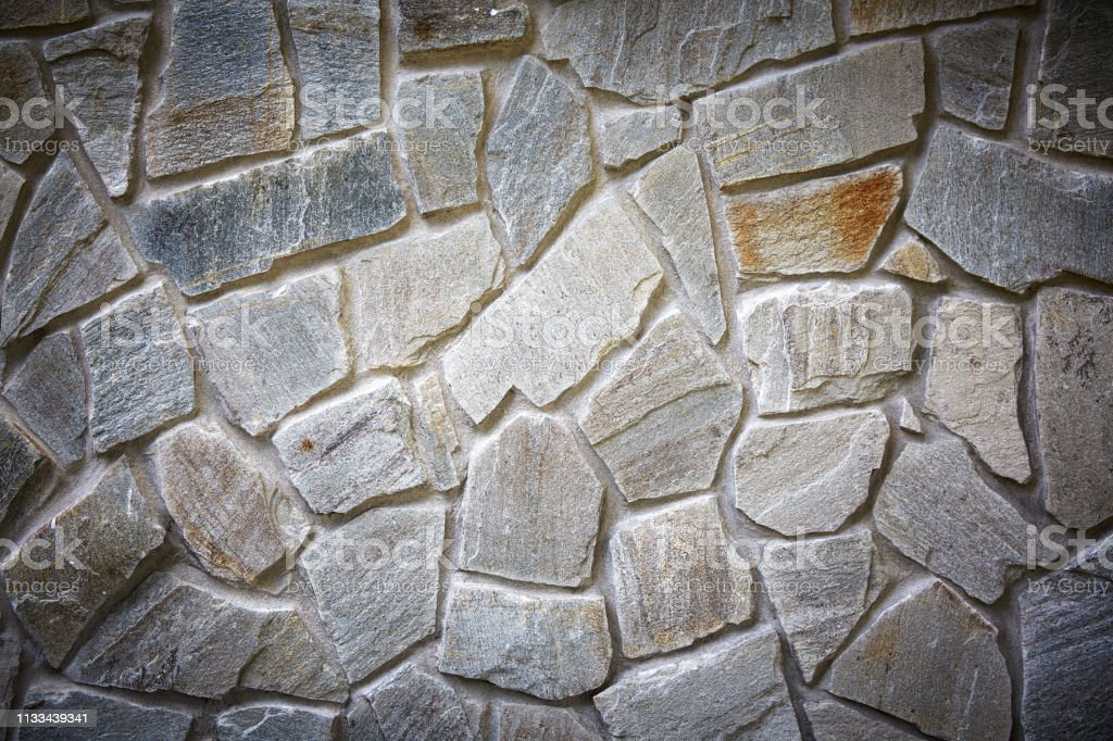 Decoratieve metselwerk. Stenen muur baksteen textuur achtergrond foto