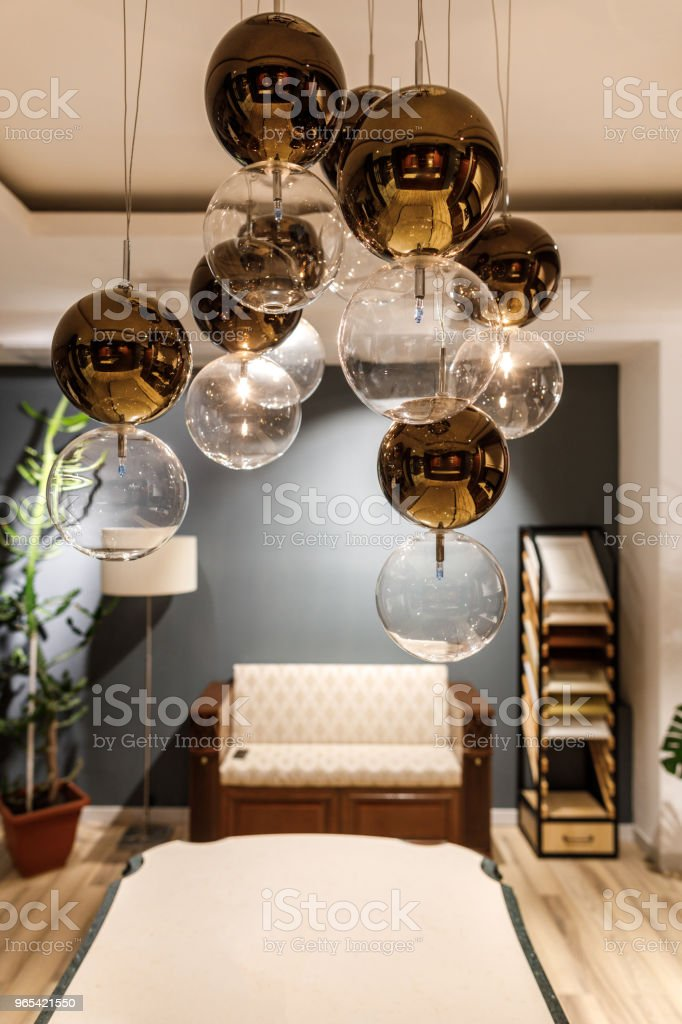 Decorative modern chandelier over table in modern room royalty-free stock photo