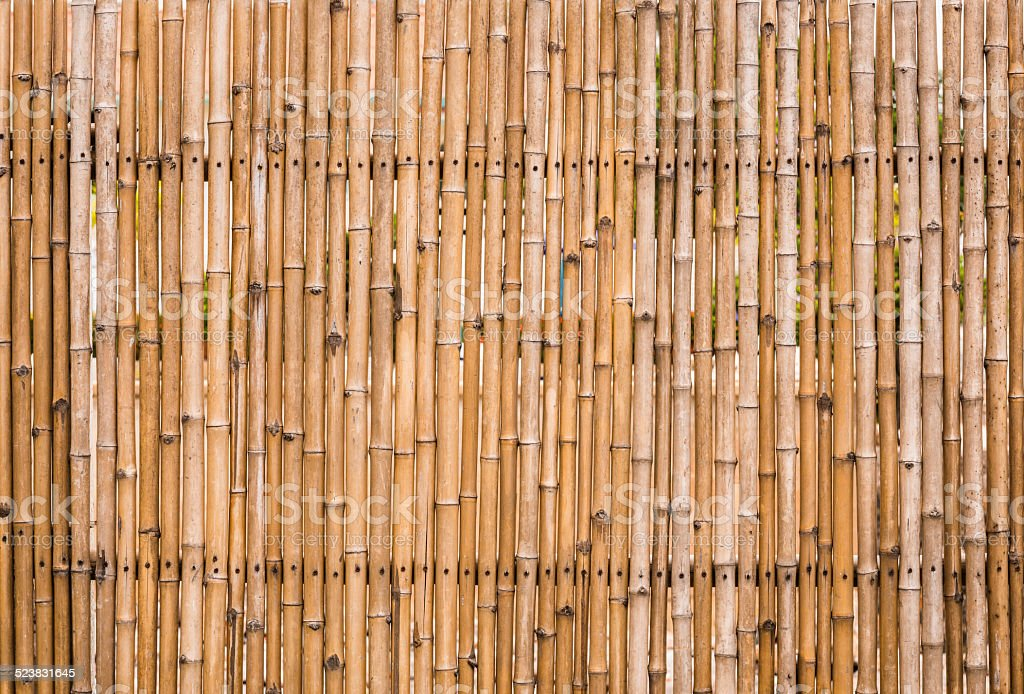 decorative old bamboo wood of fence wall background stock photo