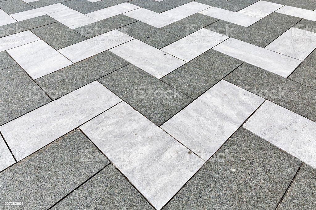 decorative old stone zigzag street tiles stock photo