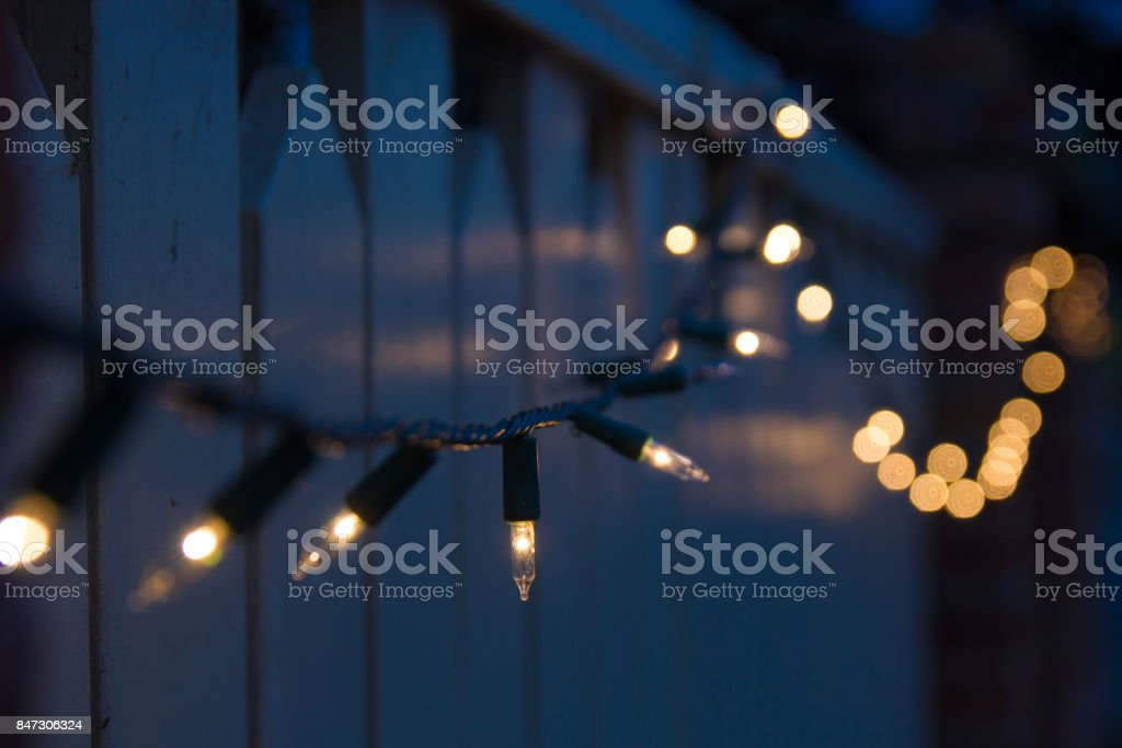 decorative outdoor christmas lights bluring into dark background stock photo