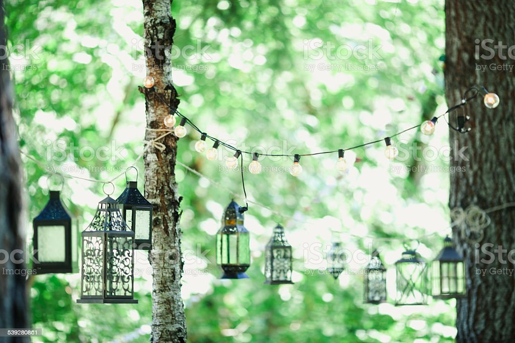 Decorative Outdoor Party Lights And Lanterns In Garden Royalty Free Stock  Photo