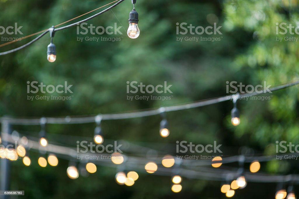 Decorative Outdoor Party Lights in Garden stock photo