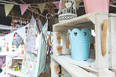 Decorative Pails and Bird Cage in Crate in Street Market