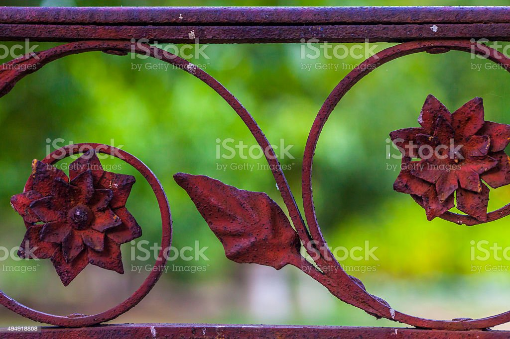 Decorative part of the iron rusty fence stock photo