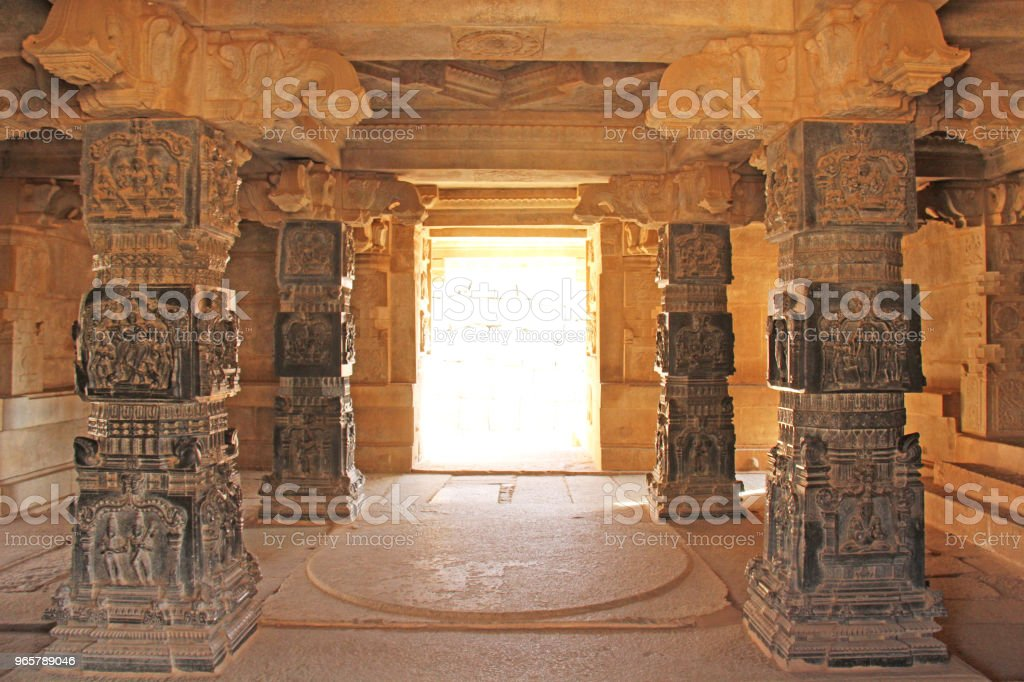 Decorative pillars from black basalt in mandappa or Hall. Hazara Rama Temple Hampi, Karnataka. Stone carving ancient. Indian God bas-relief. Carved columns with a pattern of stone - Royalty-free Ancient Stock Photo